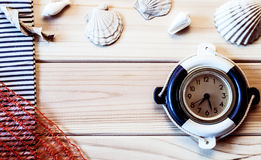 Decorative marine clock on the background of wooden boards Royalty Free Stock Image