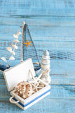 Decorative marine items on wooden background. Royalty Free Stock Image