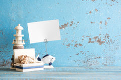Decorative marine items on wooden background. Royalty Free Stock Images