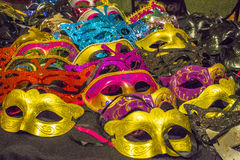 Decorative Masquerade Masks. Mix of decorative colorful Masquerade masks lined up for sale stock photography