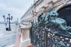 Classic sculpture in Venice, Italy. Decorative metal gate ornament. Antique iron door with classic ornaments of Campanile in Doge`s palace, Venice, Italy Stock Image