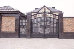 Decorative metal gates. Beautiful modern decorative metal gates Stock Photography