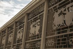 Decorative metal grate on windows of Terra Cotta Warrior Exhibit. Decorative metal grate over windows at Terra Cotta Warriors exhibition at burial site of stock images