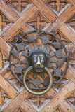 Decorative metal knocker on the door Royalty Free Stock Images