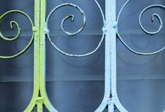 Decorative metal lattice over glass window. Dusty blue window glass. Royalty Free Stock Image