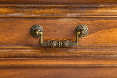 Decorative metal ornate drawer handle Royalty Free Stock Photos