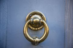 Decorative metal ring knock door. In Italy most homes have doors with these handles stock images