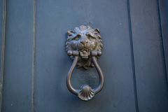 Decorative metal ring knock door. In Italy most homes have doors with these handles stock photo