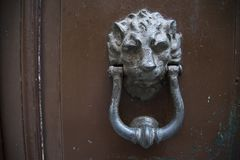 Decorative metal ring knock door. In Italy most homes have doors with these handles royalty free stock image