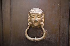 Decorative metal ring knock door. In Italy most homes have doors with these handles royalty free stock photo