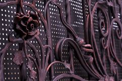 Decorative metal rose, processing of metal forged gates in dark colors.  royalty free stock photo