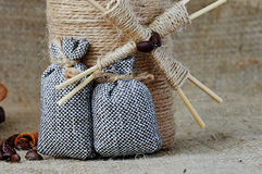 Decorative mill and small sacks for coffee Stock Images