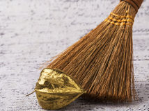Decorative mini broom. Fezalis on gold background Stock Photography