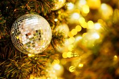 Decorative with mirror ball or Christmas ball for merry Christmas and happy new years festival with bokeh background. Have some space for write wording Royalty Free Stock Images