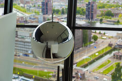Decorative mirror ball hanging  from ceiling in office tower Royalty Free Stock Photography