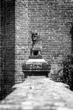Decorative monument in the shape of lion. Black and white photo. Frascarolo, Italy - June 22th, 2014: Small statue in the shape of a lion, placed as a decoration stock photography