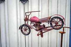 Decorative motorcycle. Handcrafted vintage motorbike as a country style garden decoration royalty free stock image