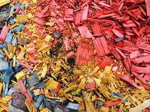 Decorative mulch of wood chips. Color background Royalty Free Stock Images