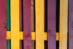Decorative multicolored wooden fence as a background Stock Photography
