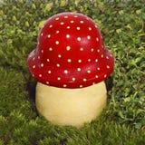 Decorative mushroom fly agaric. Decorative mushroom a fly agaric in a green grass Stock Photography