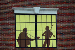 Decorative music store window advertising Stock Images