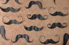 Decorative mustaches on craft paper. Father`s day concept stock photos