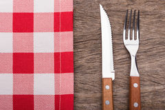 Decorative napkin, knife and fork. On texture. Royalty Free Stock Images
