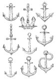 Decorative nautical anchors with chain and rope Stock Photos