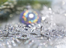 Decorative New Year's background - tinsel and a ball out of focus Royalty Free Stock Photo