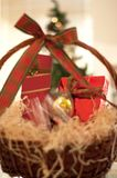 Decorative New Year`s gift baskets with a set of sweets and alco royalty free stock photos