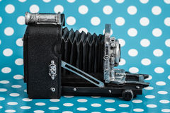 Decorative Old Antique Cameras on Blue Background Royalty Free Stock Photography