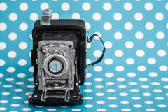 Decorative Old Antique Cameras on Blue Background Royalty Free Stock Photos
