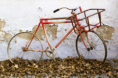 Decorative old bicycle against an old peeling wall Royalty Free Stock Photos
