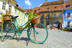 Decorative Old Bicycle Equipped with Basket in central square Royalty Free Stock Images