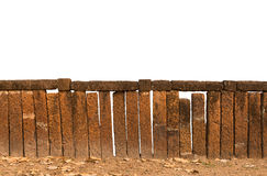 Decorative old laterite stone fence Royalty Free Stock Image