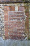 Image of a Decorative old and red brick flint wall with moss Royalty Free Stock Images