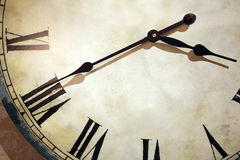 Decorative old vintage clock. With black hands and a white dial Royalty Free Stock Photography