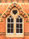 Decorative old window in building made of bricks Royalty Free Stock Photo