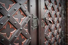 Decorative old wooden church door Stock Photography