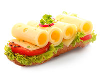 Open baguette sandwich with rolled cheese Royalty Free Stock Photos