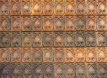 Decorative orange tone color  terracotta tiles wall Royalty Free Stock Photos