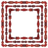 Ornately colored symmetrical page decoration items Royalty Free Stock Photos