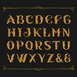 Decorative ornate alphabet vector font. Golden leaf letters. Stock Photo