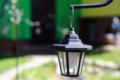 Decorative outdoor led lantern on stand with solar panels Stock Image