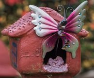 Decorative Outdoor Metal Butterfly Outside A Fake House stock photos