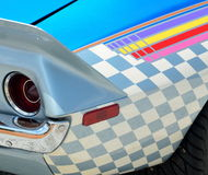 Decorative paint on antique car. Bright, decorative paint on the side of a classic car at an auto show stock photos