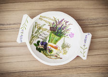 Decorative painted bowl on the wooden background, Easter decorat Royalty Free Stock Photography