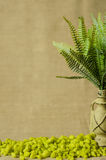 Decorative painted lamp with ferns and decorative green stone. Stock Images