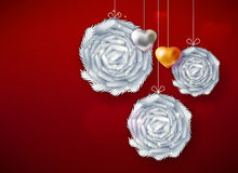 Decorative paper art balls. Decorative balls and hearts for Happy New Year on red background. Christmas garland decoration. Christmas fir branches design. New Royalty Free Stock Photos