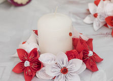 Decorative paper flowers. Origami and candle Stock Image